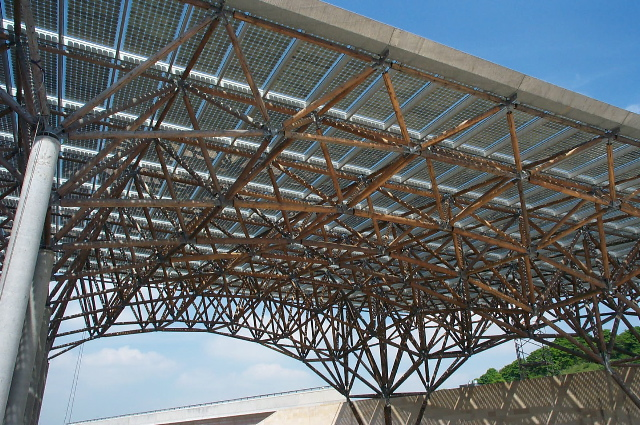 Pvs plus timber the earth centre s solar canopy for Timber frame bridge